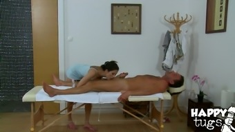 Bosomy Oriental hottie gives head white colored big penis in massage parlor
