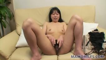 Yasuko Haraguchi takes into consideration lovely her pussy along with tiny dildo
