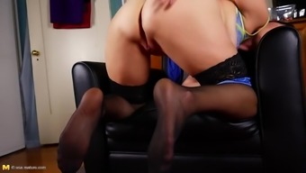 Mom bating her large clit and vagina on sofa