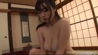 Mini-skirt clad Asian cougar along with extraordinary juggs playing with a stranger's cock