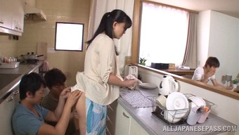 Hot cougar getting her pussy remarkable in the cooking area