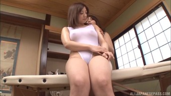 Big titty Japanese masseuse seduces a girl and nuts and bolts her