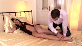Open babe Stracy gives a warm footjob