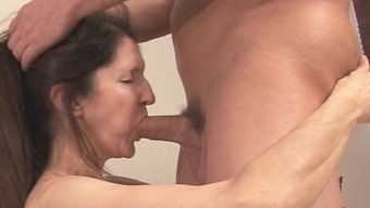 Filthy mature touching a fat phallus