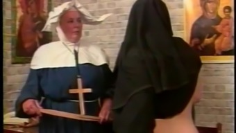 Mean nun gets her booty spanked inside a parody intercourse video files