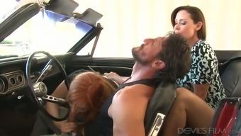 Professional dark MILF saw wayward brunette touching large penis of their stud in car