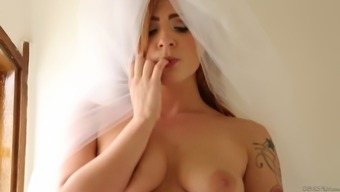 Wavy haired bride gets her handle fucked before using a dong