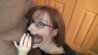 Red-haired milf in eyeglasses face fucks a smallish phallus inside