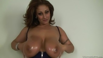 Huge-breasted mum gives a blowjob along with a titjob and gets facialed
