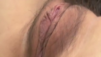 Reasonably Oriental maid in stockings Nao Kojima is little finger fucked and licked
