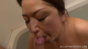 Bubbly Japanese people milf delivers a tit position after having a bubbly bathroom