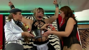 Femdom lesbian threesome with the use of chained blond