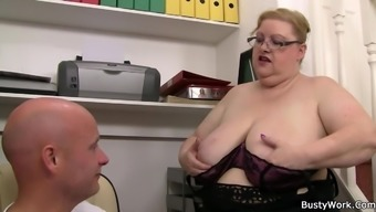 Big tits lady supervisor in spectacles tours his dick