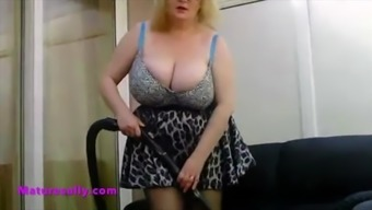 Granny doing her housekeeping in a notably small skirt