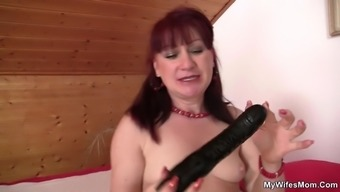 Girlfriend's old mom makes use of dildo and amusement rides his cock