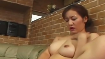 All nude MILF Reiko Kamiya tickles his or her own pussy and wanks robust prick