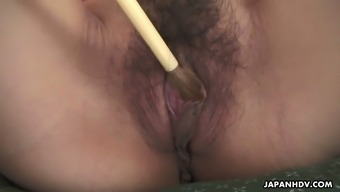 Unrestrained bf tickles adorable Japanese people hottie Yuria Tominaga's pussy by using a brush
