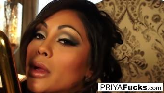 Dining room fun with sexy Priya Rai and a golden vibrator