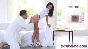 Bosomy brunette April O'Neil enjoys receiving a throbbing dick