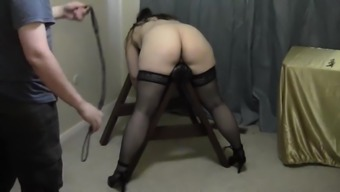 Enjoy super slut Liza tied up on a horse bench and receiving her well-deserved ass punishment