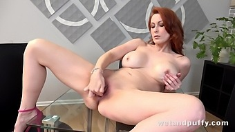 Redheaded MILF charmer with big boobs is toying her delicious sweet pussy