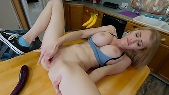 Naughty solo chick Katie Monroe opens her leg to insert a banana