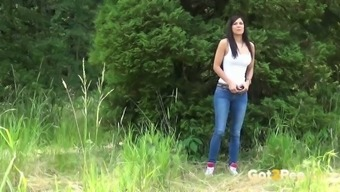 Feisty blonde lady in denim pants Rebecca pees among the woods