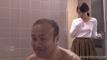 Charming companion within the pleated mini skirts chop by touching off another man