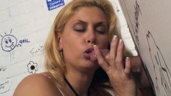 Plump blonde Milf rams her clit against penis for the gloryhole