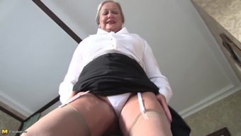 Beautiful matured in casks granny in nylon material stockings stripteasing seductively within