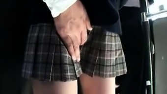 Adorable Oriental schoolgirl has a naughty stud touching her puss
