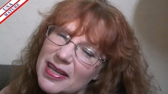 Nerdy homemaker with the use of glasses easily adds the shaft into her lips