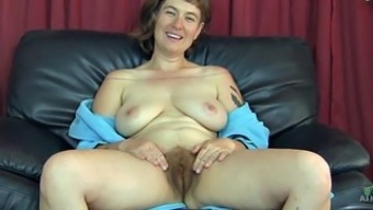 Very hairy grow older roam flaunts her wet love probe
