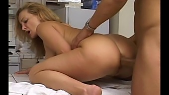 Impure brown mum dressing eyeglasses gets her cunt drilled in the cooking area