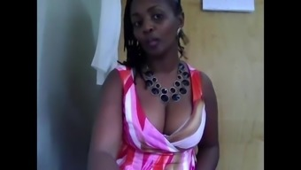 African-american MILF in business office on camera
