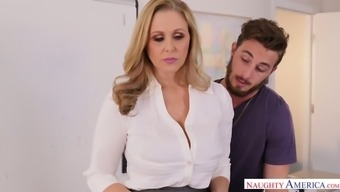 Yummy busty milf Julia Ann is fucked in the heart of the table by Johhny Stack
