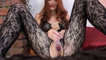 Gyno dildo in her substantial redheaded vaginal canal